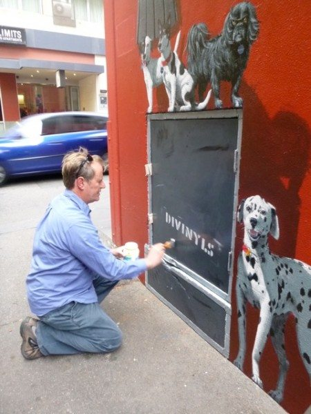 Peter Gouldthorpe painting Chrissy's Divinyls amplifier and her dogs (Image: Peter Gouldthorpe)