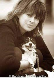Photograph of Chrissy Amphlett and her dogs by Reg Ryan.